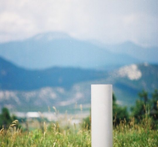 drinking_post_automatic_waterer_installed_in_field_with_mountains_in_background
